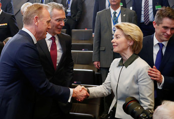 U.S. Secretary of Defense Shanahan shakes hands with German Defence Minister von der Leyen during a NATO defence ministers meeting in Brussels