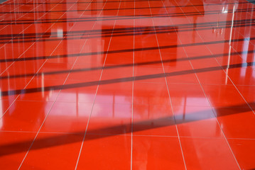 Abstract red floor structure with shadows and reflections