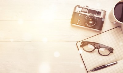 Vintage camera, diary with pen and cup