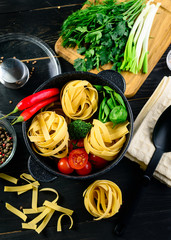 original Italian style pasta dinner on dark background. Italian cuisine