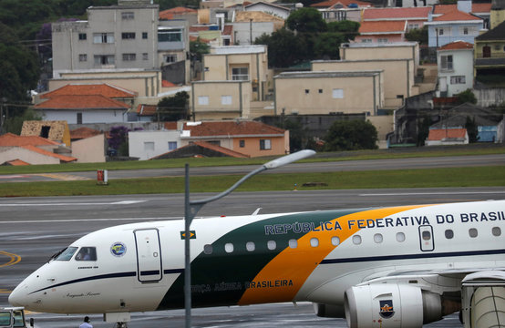 The presidential airplane transporting Brazil's President Jair Bolsonaro is seen before taking off at the Congonhas airport after leaving the Albert Einstein Hospital in Sao Paulo