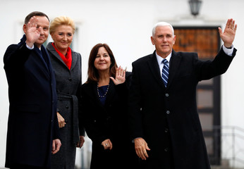 U.S. Vice President Mike Pence, his wife Karen, Polish President Andrzej Duda and his wife Agata Kornhauser-Duda pose outside Belvedere Palace in Warsaw