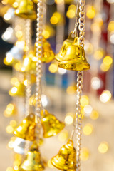 Small golden bells hanging with bokeh background