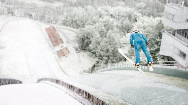 Ski jumper flying through the air during a practice session at the Lake Placid, NY, ski jumps