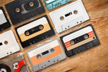 Collection of retro audio tapes on background