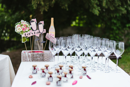 wedding reception table with champagne glasses and flowers