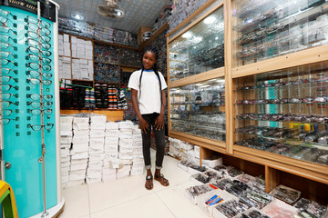 Igbalulu Eucharia, 23, poses for picture in a store in Abuja, Nigeria
