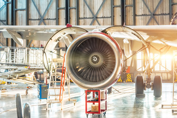 Industrial theme - repair and maintenance of aircraft, view of the airplane engine jet
