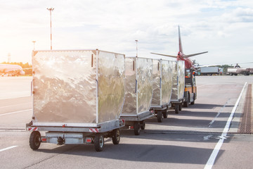 Trailers with containers of onboard aviation food for loading into a passenger airplane