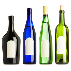 Group of four different bottles with blank labels