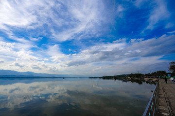 Kwan Phayao; a lake in Phayao province, the North of Thailand. Shooting with the rule of thirds between river, cloud, and sky.