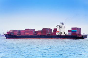 Ship full loaded with containers against blue sky