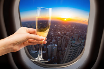Glass of wine and Chicago view from plane window