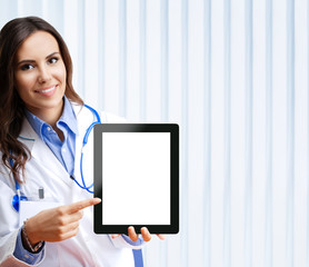 Doctor showing blank tablet pc for copyspace