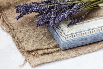 Corner of frame border. Decorative baguette and lavender flowers.