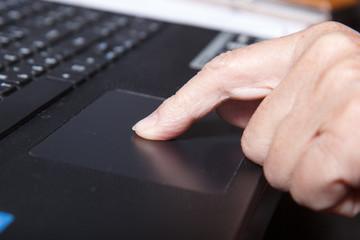 old woman usin laptop