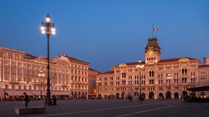 Piazza dell'Unita in Trieste with Palazzo del Municipio shot at sunset in soft pink light