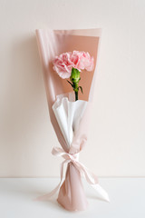 Spring flowers. Fresh bouquet in minimal style on light background. Top view, spring flat lay. Love and gift concept