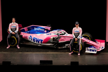 SportPesa Racing Point F1 Team drivers Perez and Stroll pose after unveiling their team's new car livery at a pre-season launch event at the Canadian International AutoShow in Toronto