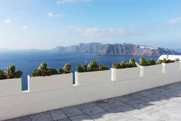 Boulevard in the city of Oia overlooking the Mediterranean Sea. Santorini