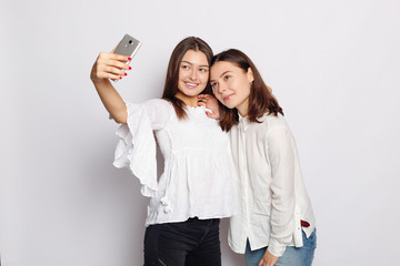 Selfie time, Young funky blogger is making photo for her social networks page. Beautiful girlfriends taking a self shot with phone.