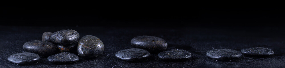 Printed roller blinds Zen Panoramic image of zen stones with water drops on a black background