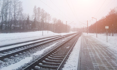 Winter landscape along the emty railway line in forest