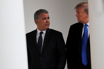 U.S. President Donald Trump walks with Colombian President Ivan Duque at the White House in Washington