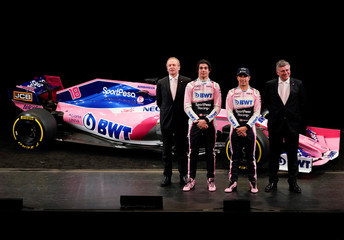 SportPesa Racing Point F1 Team drivers Stroll and Perez pose with team principal and CEO Szafnauer, and technical director Green, after unveiling their team's new car livery at a pre-season launch event at the Canadian International AutoShow in Toronto