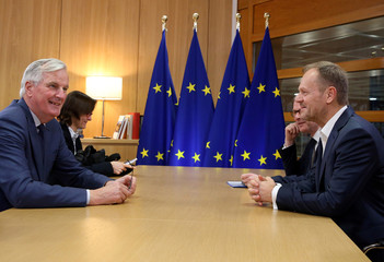 The European Commission's chief Brexit negotiator Michel Barnier and President of the European Council Donald Tusk speak ahead of a meeting at the European Council in Brussels