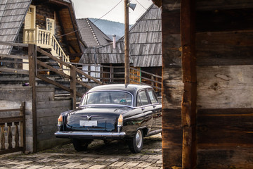 Oldtimer car in traditional retro village