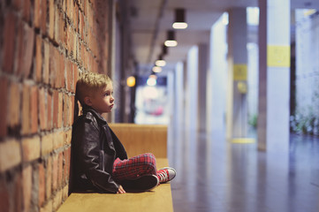 Photo of a nice young boy, 5 years old, in a modern interior, fashionably and stylishly dressed. Small model session.