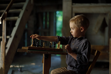 A boy in an old mill playing chess. Mysterious place in the old house. Image for book cover.