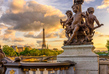 Wall Mural - Sculpture on the bridge of Alexander III with the Eiffel Tower in the background at sunset in Paris, France