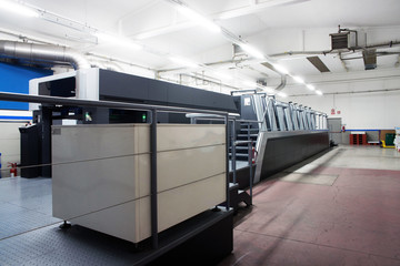Press printing - Offset machine. Printing technique where the inked image is transferred from a plate to a rubber blanket, then to the printing surface.
