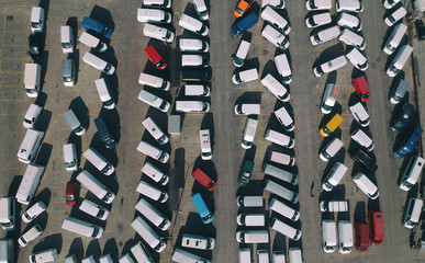 Aerial view of new cars in the parking.  imported new vehicles - outdoor parking various type cars