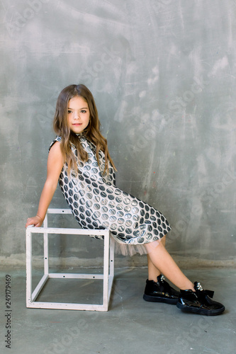 e3b8cd4dc8c5 Fashion model on grey background, beauty. Fashion and beauty, little  princess. Child girl in stylish glamour dress, elegance. Little girl in  fashionable ...