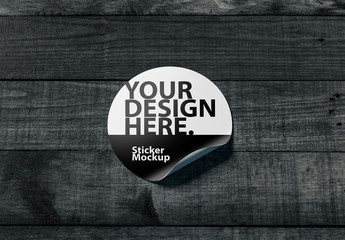 Round Sticker on Wooden Surface Mockup