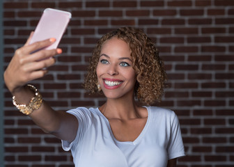 Young Attractive Woman Smiling and Taking a Selfie