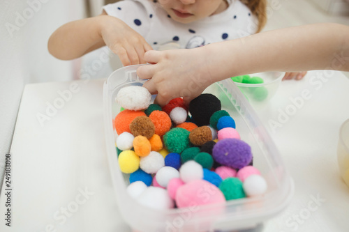 Toddlers playing multicolored educational games, mosaic and puzzles