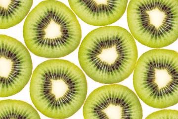 Background texture pattern of Kiwi fruit, slice of green juicy kiwi. isolated on white