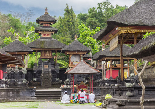 People praying at the Besakih temple on Bali, Indonesia