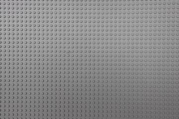 background. Gray plastic game board for a children's designer.