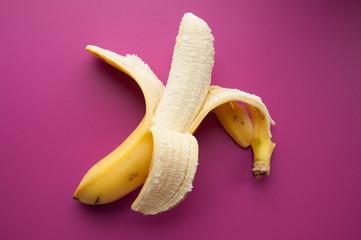 Yellow ripe banana on a pink background