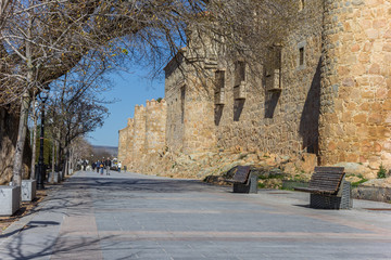 Fototapete - Boulevard along the old city walls of Avila, Spain