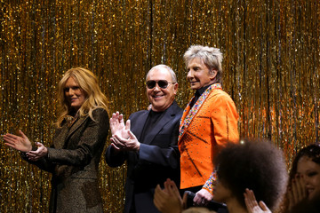 Designer Michael Kors applauds after presenting his collection during New York Fashion Week in New York