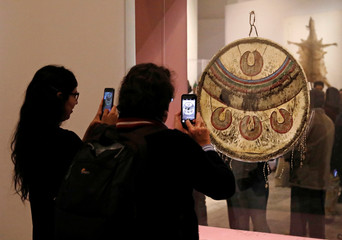 Journalists take pictures at a chimalli during a media tour as Mexico's National History Museum at Chapultepec Castle opens exhibit, showcasing the chimalli or Aztec Shiel
