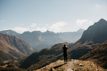 Switzerland, Engadin, woman standing in mountainscape