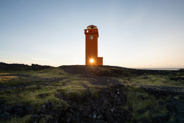 Sunlight streaming through lighthouse window against sky during sunset at Iceland