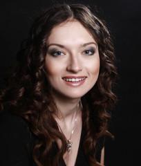 closeup of beautiful young woman in evening black dress
